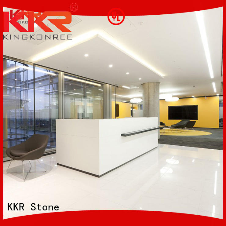 curved reception desk unique for building KKR Stone